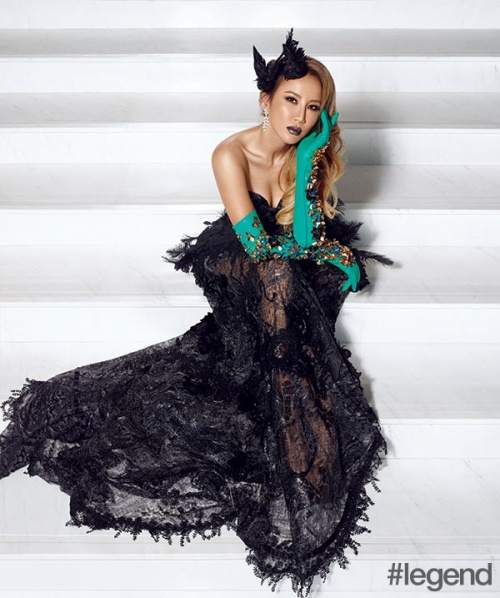 CoCo Lee wears dress and headpiece by Lawrence Xu, gloves by Delpozo and jewellery by Sunfeel
