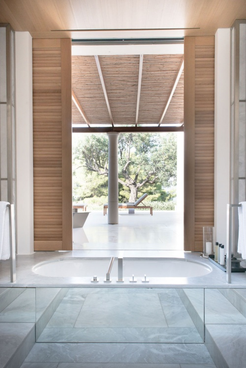 A luxurious bathtub with a view at Amanzoe, in the Peloponnese countryside, Greece