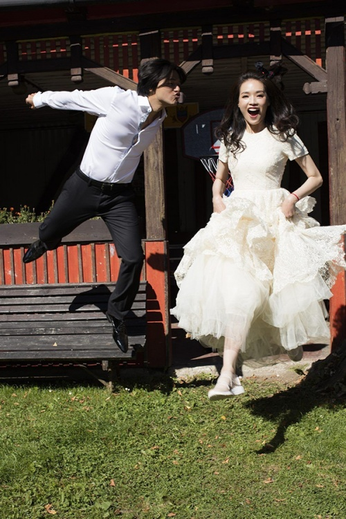 Shu Qi wears a wedding gown from H&M's 2014 Conscious Exclusive collection (Credit: Vogue Taiwan)