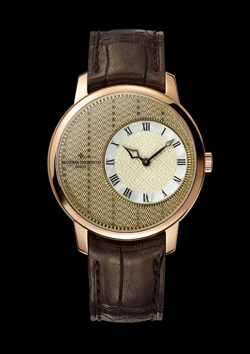 "The Vacheron Constantin ""Métiers d'Art Elégance Sartoriale"" watch with a pinstripe pattern and a translucent linen-colored Grand Feu enamel finish"