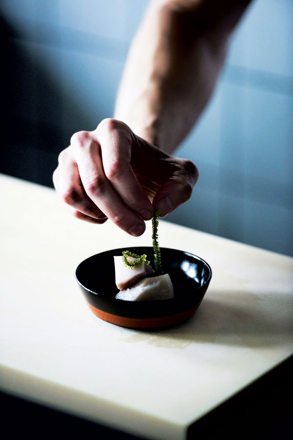 Placing the finishing touches on an omakase dish (photo by Jason Lang)