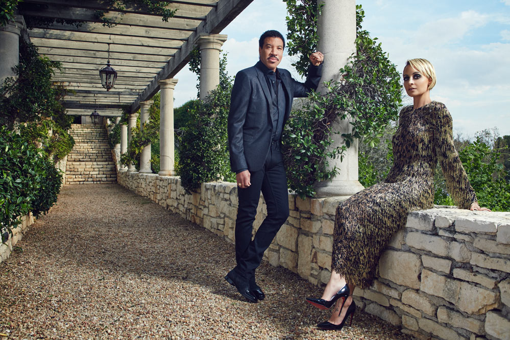 Lionel Richie wears a Saint Laurent jacket, shirt by Scabal, denim by Acne and Jimmy Choo boots. Nicole Richie wears a Nicholas Oakwell Couture dress and Christian Louboutin shoes