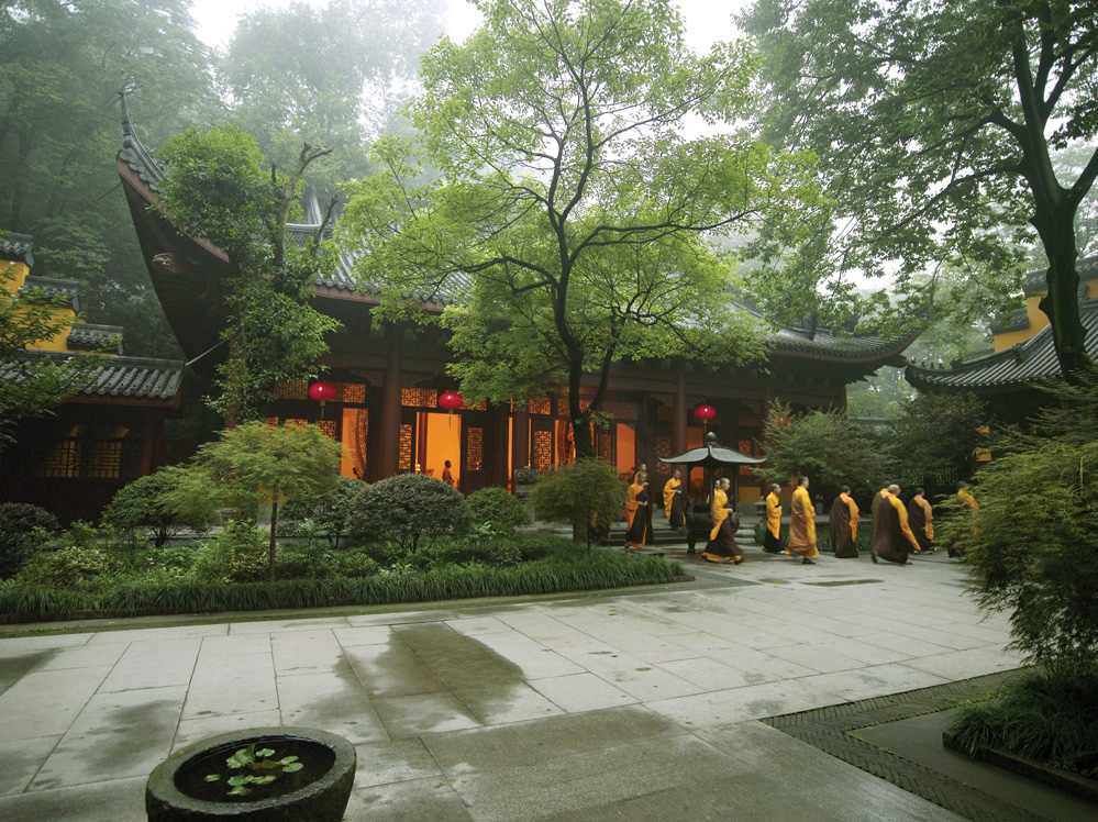 Monks leave a Buddhist temple next to Amanfayun in Hangzhou, China