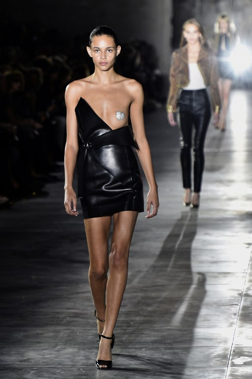 The mono boob dress at the Saint Laurent show during Paris Fashion Week (Credit: Bertrand Guay / AFP Photo)