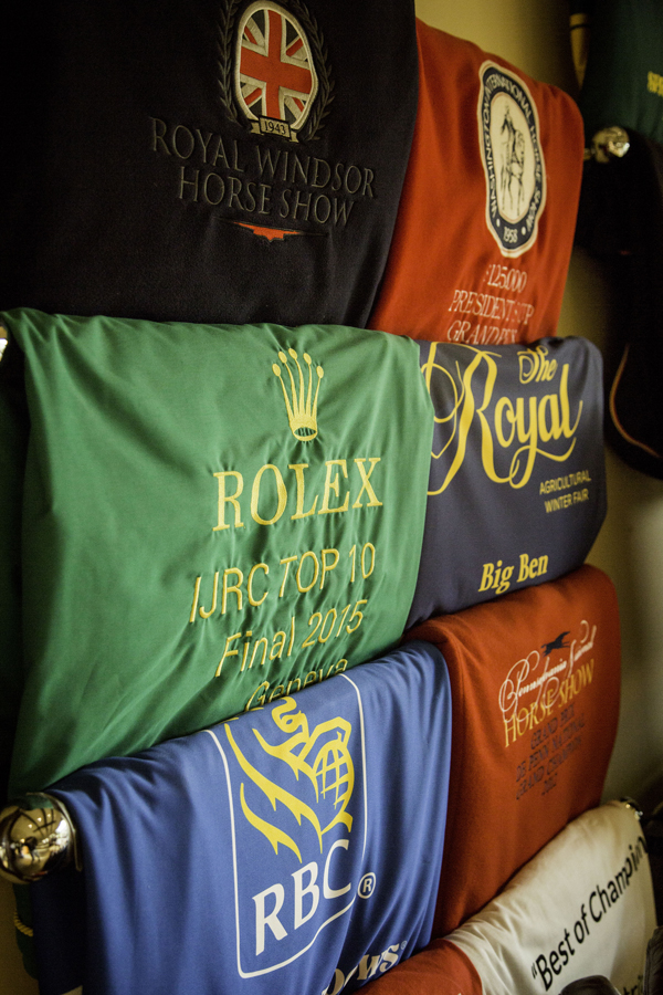 The prize rugs hanging in the barn