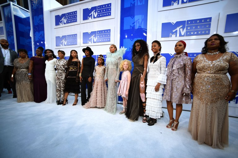 Beyoncé and her guests, mothers of gun violence, on the white carpet (Photo by Larry Busacca / Getty Images)