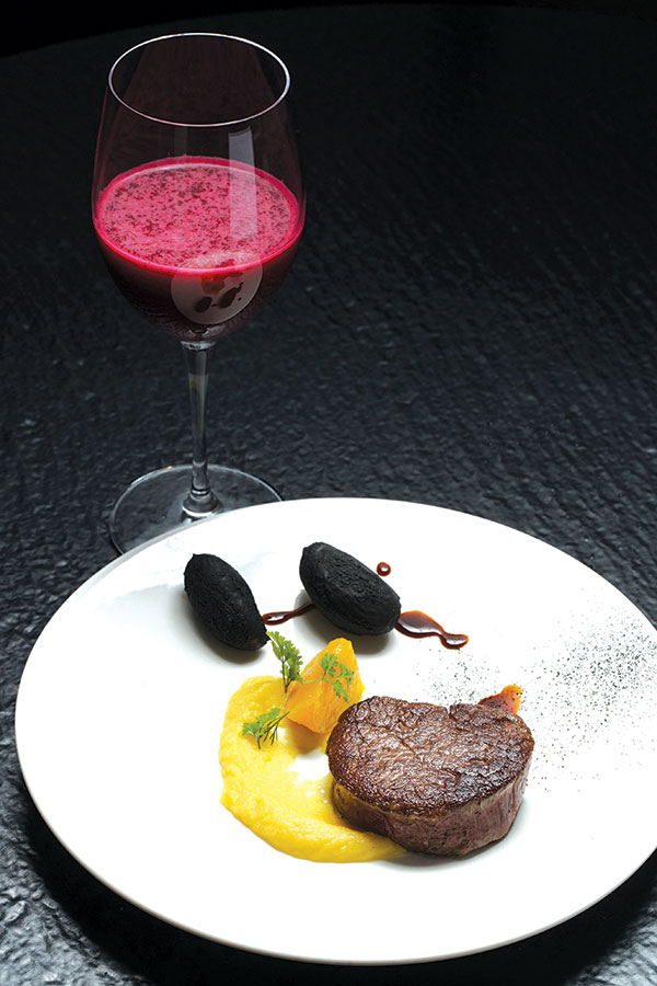 Beef served with black potatoes, paired with la vie en rose juice