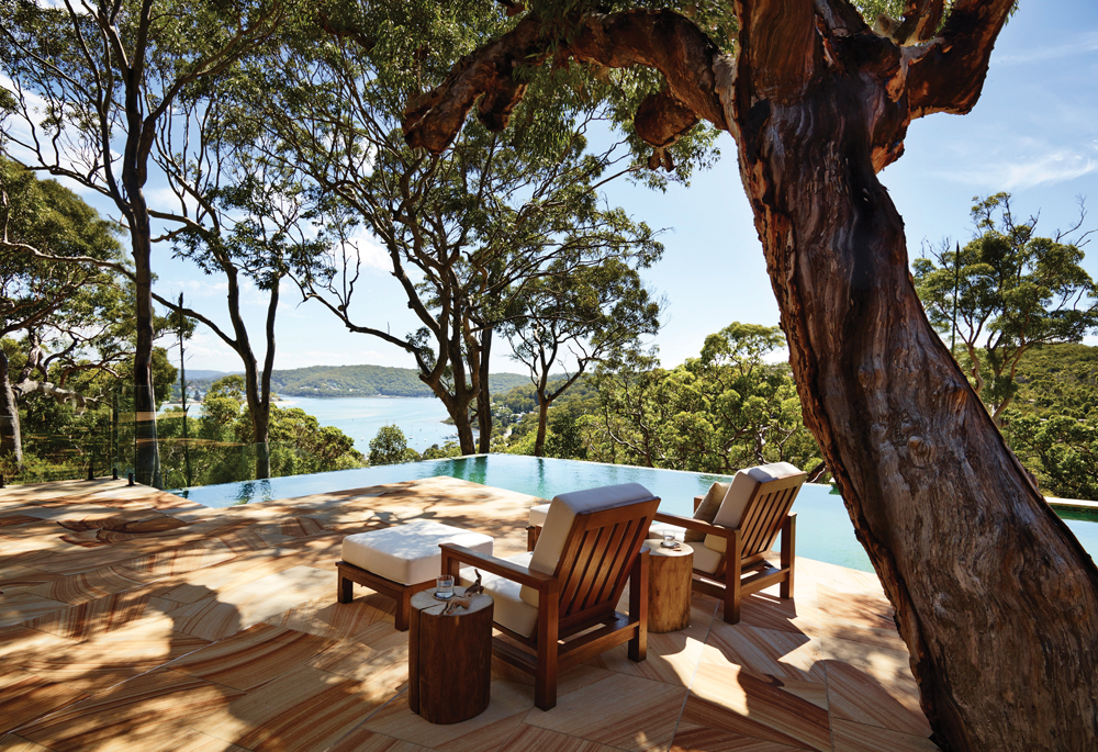 The tree-shaded pool area offers sweeping views of verdant nature and the Tasman Sea