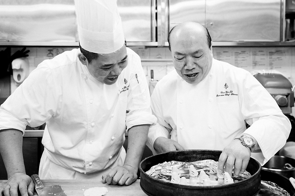 Chef Ming prepares a dessert with chef Chan Yan-tak of Lung King Heen