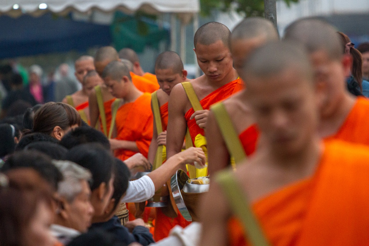 Young monks collect their morning alms