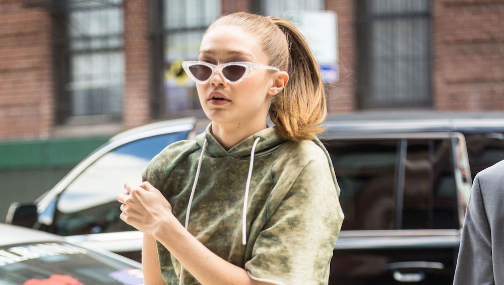 Gigi Hadid wearing cat-eye sunglasses.
