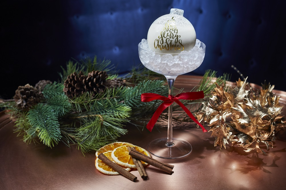 The Noel Nightcap is served inside an adorable glass ornament