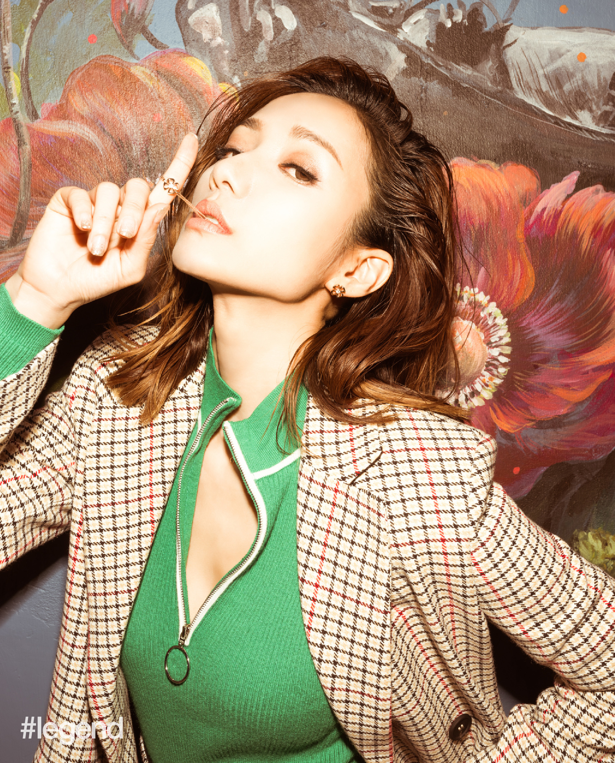 Grace wong in plaid jacket and green shirt