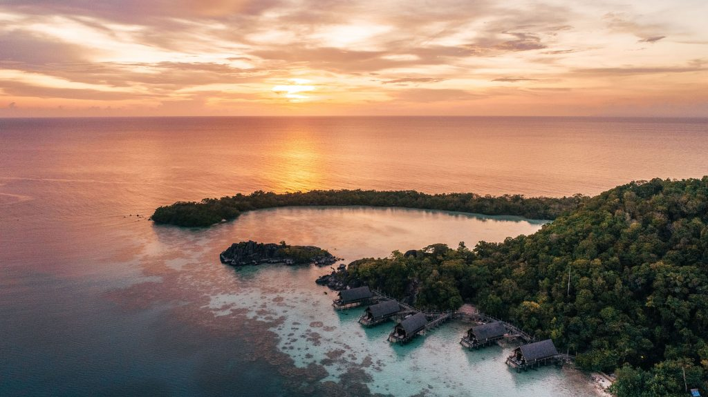 aerial_overwater_suite_sunset_with_setigi_reef_background-min